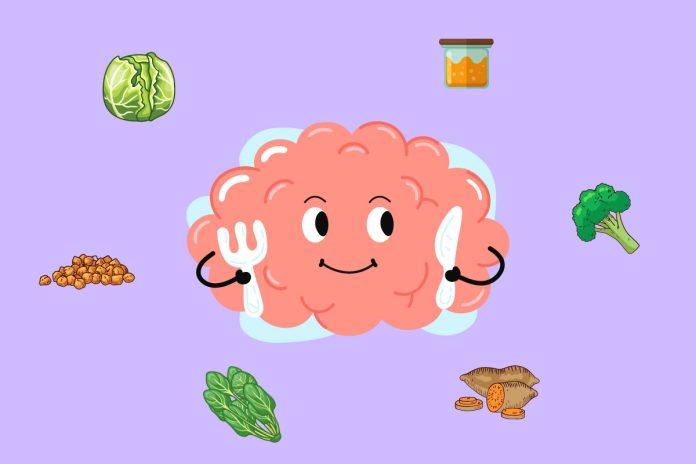 13 alimentos superpoderosos para a saúde das crianças; ilustração do cérebro com garfo e faca na mão olhando para comidas ao seu redor
